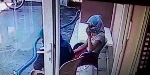 Kadın kılığında kameralara yakalandı