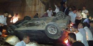 Köprüden uçan araçtan yara almadan kurtuldu