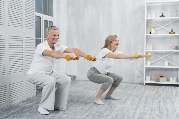 smiling-elder-couple-performing-exercise-with-dumbbells-home_23-2148097466.jpg