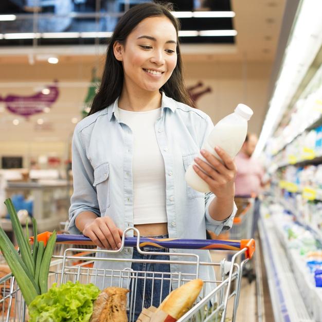 woman-inspecting-bottle-milk-grocery-store_23-2148216109.jpg